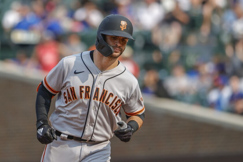 San Francisco Giants' Tommy La Stella rounds the bases after hitting a three-run home run off Chicago Cubs relief pitcher Tommy Nance during the fifth inning of a baseball game, Saturday, Sept. 11, 2021, in Chicago. (AP Photo/Kamil Krzaczynski)