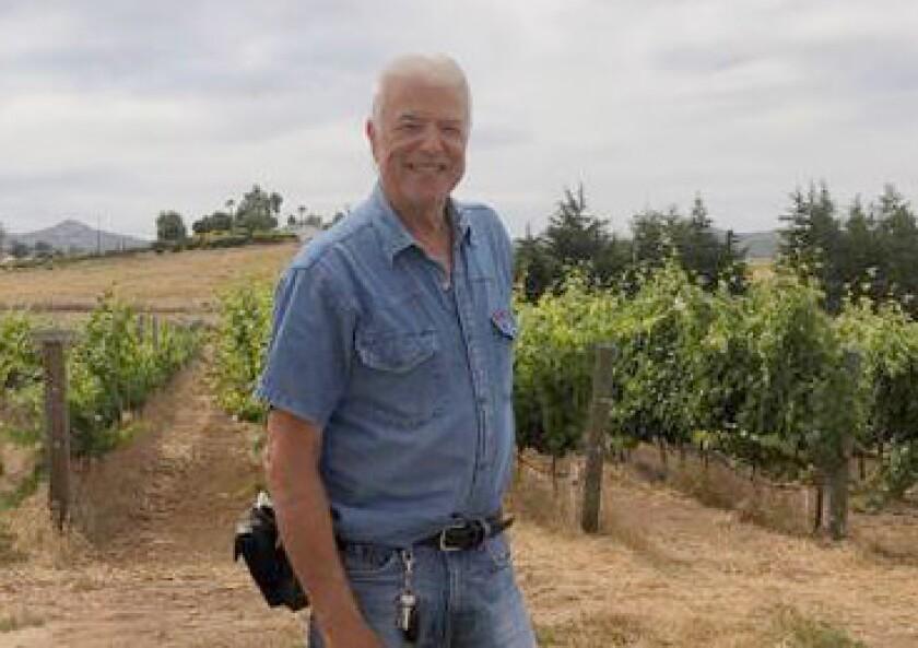 Principe di Tricase Winery owner and winemaker Alfredo Gallone, above, helped partners Raffaella Gallone-Sepe and her husband Alberto Sepe transfer barrels of wine into 15,000 bottles during the coronavirus shutdown.