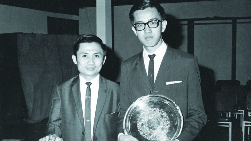 Jahja Ling and his early piano teacher, Rudy Laban, circa 1969 in Jakarta. Ling is holding his First Prize Challenge Cup for the Jakarta Piano Competition in March of 1969.