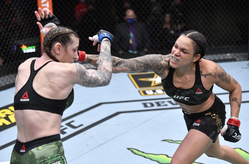 LAS VEGAS, NEVADA - MARCH 06: (R-L) Amanda Nunes of Brazil punches Megan Anderson of Australia.