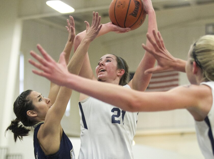 FULLERTON, MARCH 9, 2015 - Vanguard University's Samantha Doucette goes up for a shot against The Ma