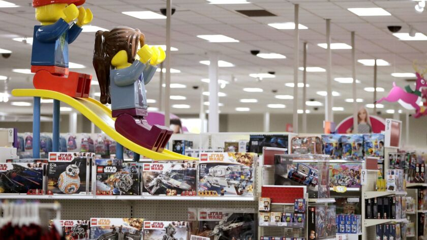 In this Friday, Nov. 16, 2018, photo a display shows two large Lego toys on a slide near the toy sec