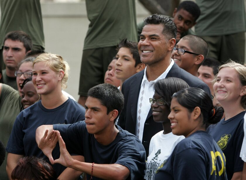 This is from September 2011, when Junior Seau met with ROTC students as he hosted the dedication of a training course for students at Oceanside High School. • U-T San Diego file photo