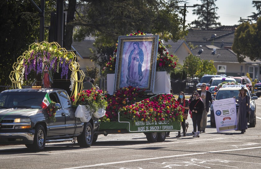 Parishioners celebrate Virgen de Guadalupe during a procession Sunday in San Gabriel.