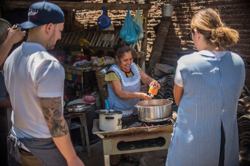Puesto's Eric Aronow and Katy Smith, on a research-and-development trip to Oaxaca, watch Doña Irma make Estofado de Boda, a type of mole.