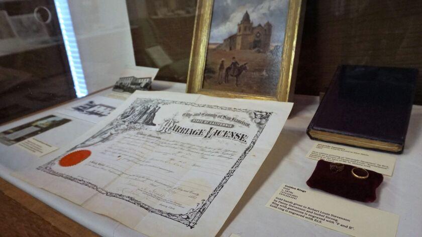 Display case housing the marriage license for Robert Louis Stevenson and Fanny Osbourne (nee Van De