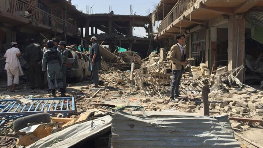 Residents view the damage after an explosion in Kabul, Afghanistan, on Aug. 7.