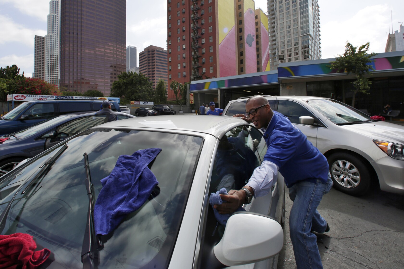 Downtown L A  carwash owner cleans up in sale estimated at $25