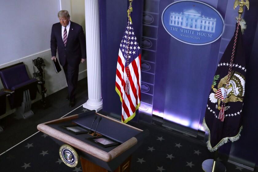President Trump arrives to speak in the White House media briefing room Nov. 5.