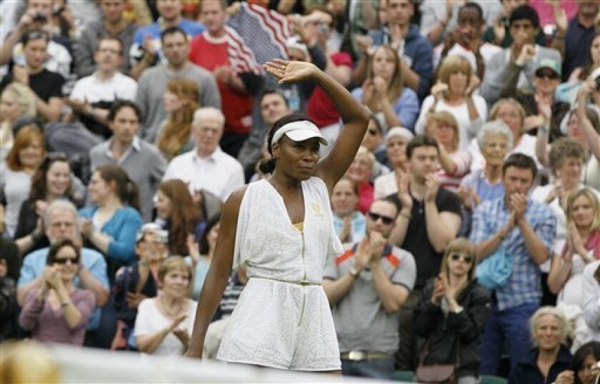 Venus Williams of the US waves to the crowd after defeating Japan's Kimiko Date-Krumm at the All England Lawn Tennis Championships at Wimbledon, Wednesday, June 22, 2011. (AP Photo/Kirsty Wigglesworth)