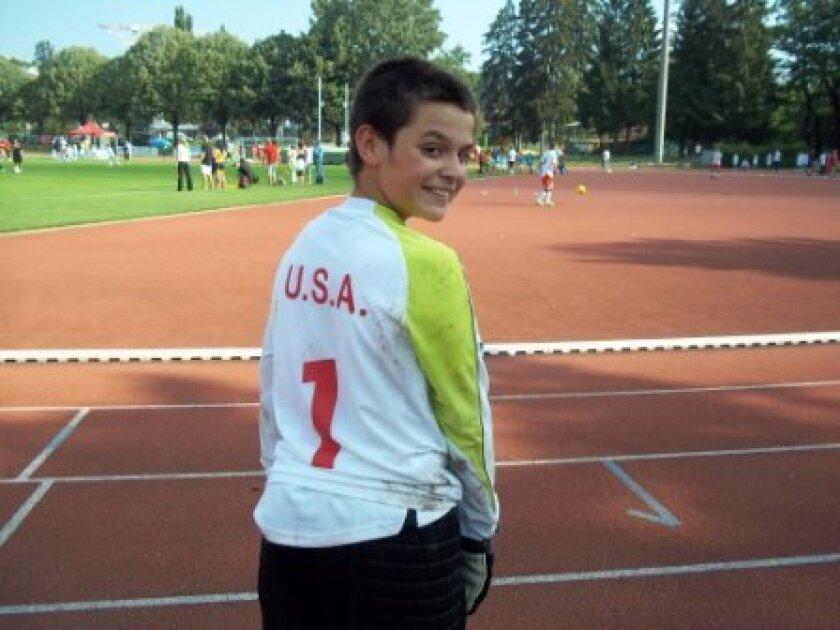 Joseph Valadez, 11, shows his U.S. team jersey.