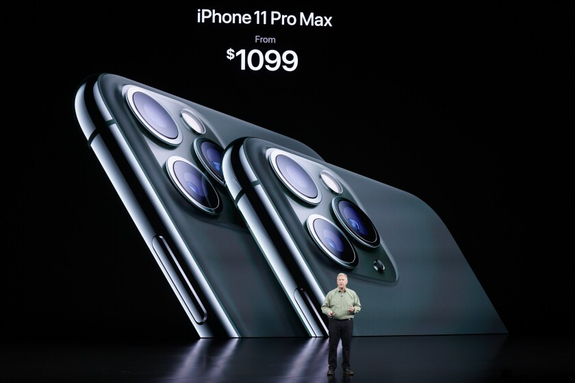 In this Sept. 10, 2019, photo, Phil Schiller, Senior Vice President of Worldwide Marketing, talks about the new iPhone 11 Pro and Max, during an event to announce new products in Cupertino, Calif. Apple's iOS 13 software update comes with plenty of privacy enhancements - though in some cases, you need to take the time to understand how they work. Among the changes: You'll be able to sign in to third-party services with your Apple ID account rather than Facebook's or Google's. The free update is available for existing iPhones on Thursday, Sept. 19 and will ship with new models out Friday, Sept. 20. (AP Photo/Tony Avelar)