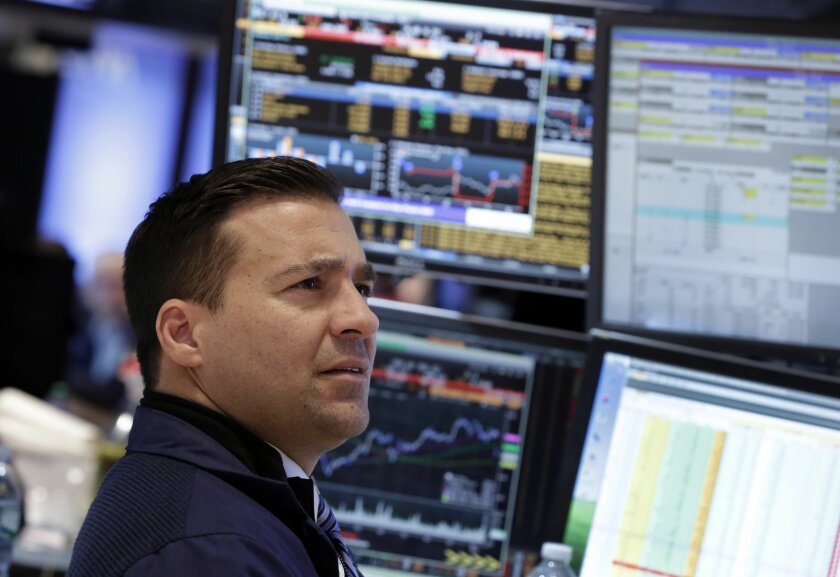 FILE -In this Wednesday, Jan. 29, 2014, file photo, specialist Paul Cosentino works at his post on the floor of the New York Stock Exchange. Shares were lower Thursday Jan. 30, 2014 as weak economic data from China and Japan deepened jitters over ongoing reductions in U.S. monetary stimulus. (AP Photo/Richard Drew)