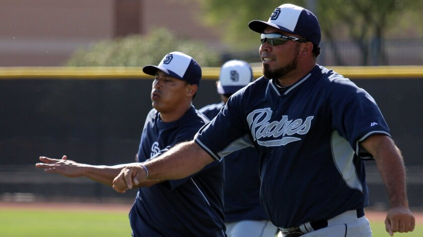 Padres pitcher Joaquin Benoit circles his arms during spring training in Peoria, Ariz.