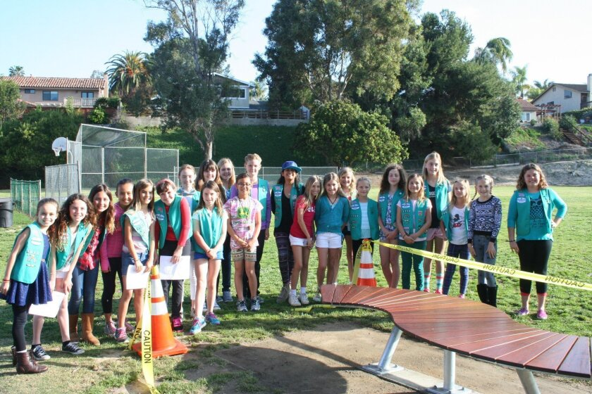 Three Solana Beach Girl Scout troops teamed to build the Buddy Bench.