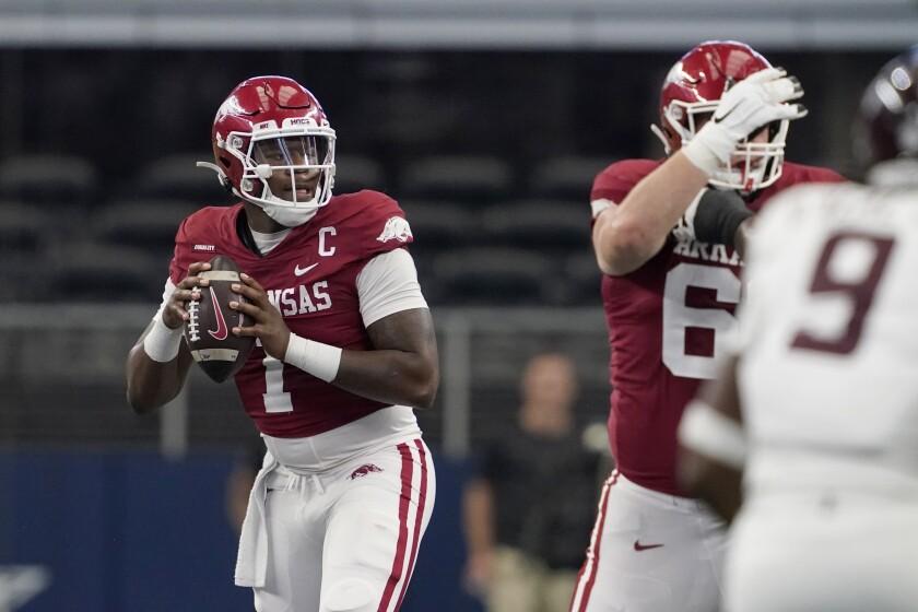 Arkansas quarterback KJ Jefferson (1) prepares to throw a pass in the first half of an NCAA college football game against Texas A&M in Arlington, Texas, Saturday, Sept. 25, 2021. (AP Photo/Tony Gutierrez)