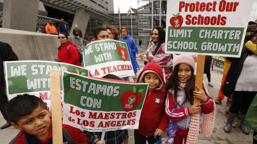 LOS ANGELES, CA - JANUARY 15, 2019 Students from Main Street School holds signs in support as teach