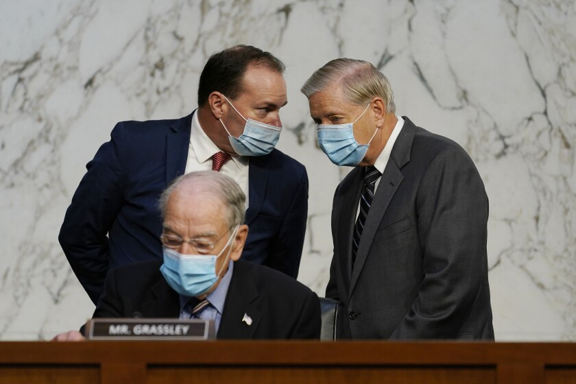 Republican Sens. Charles E. Grassley, seated, Mike Lee, left, and Lindsey Graham.