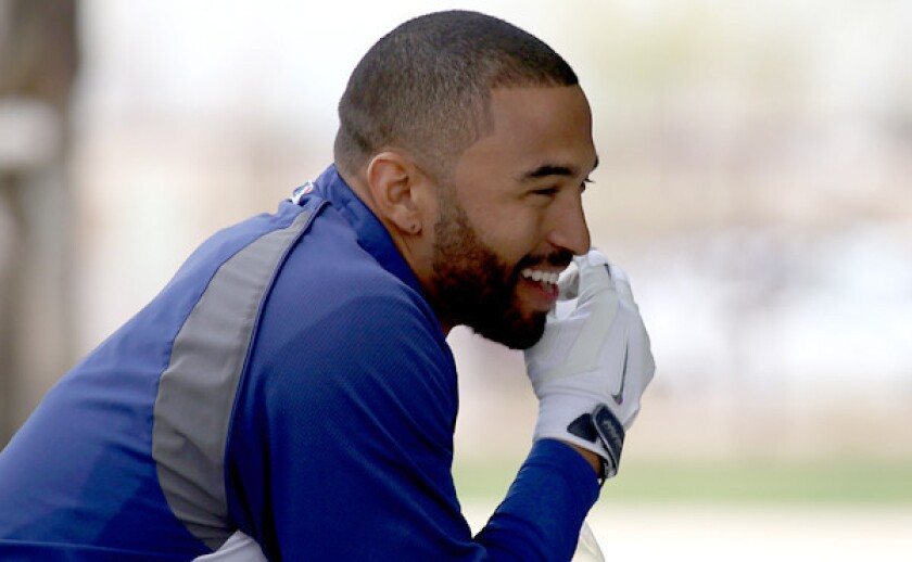 Dodgers outfielder Matt Kemp smiles during batting practice at the team's spring-training facility in Glendale, Ariz., on Tuesday. Kemp hopes to see some playing time in Cactus League play before the regular season begins.