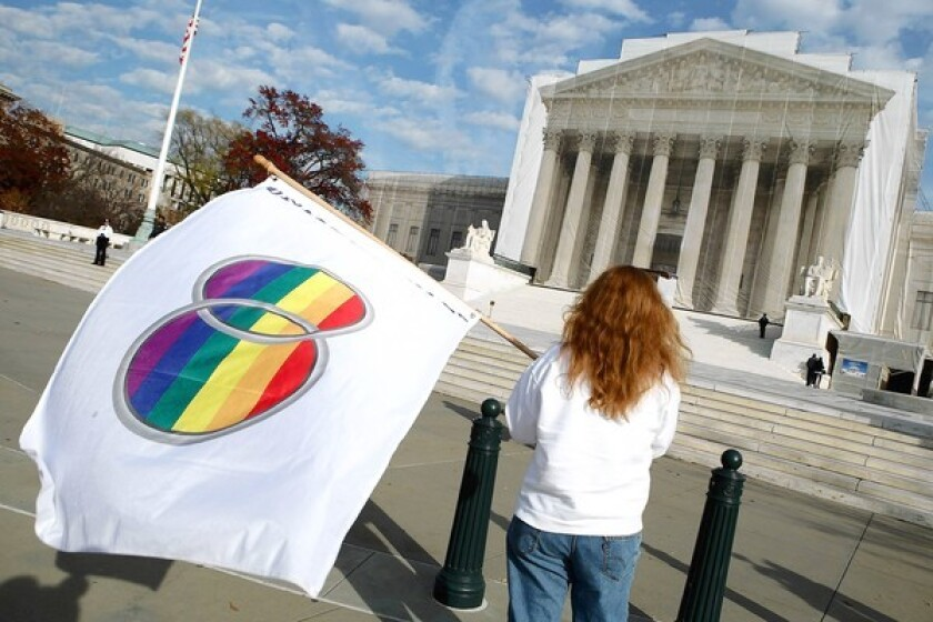 Gay-rights demonstrators stand in front of the U.S. Supreme Court building in 2012.