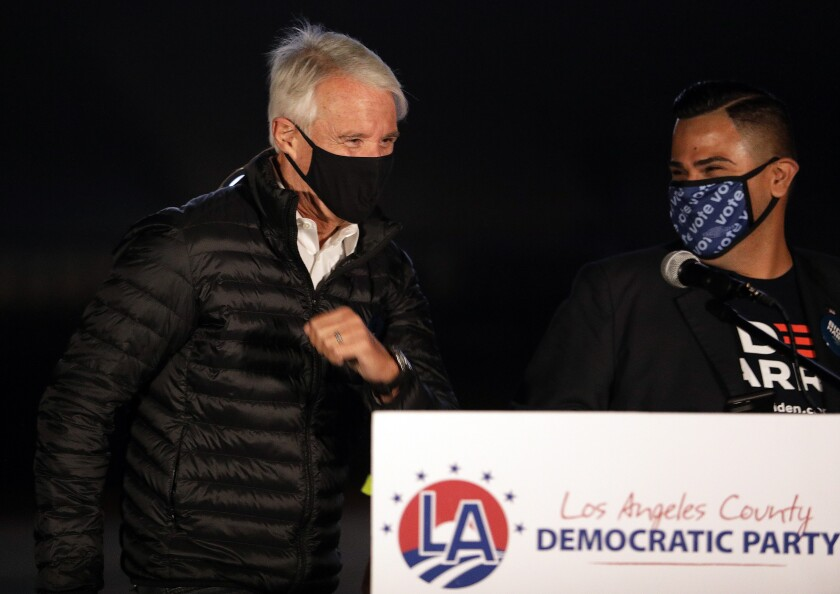 George Gascón, left, is introduced by Mark Gonzalez, chair of the Los Angeles County Democratic Party.