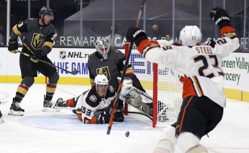 Ducks left wing Max Comtois looks up at center Sam Steel after scoring against the Vegas Golden Knights.