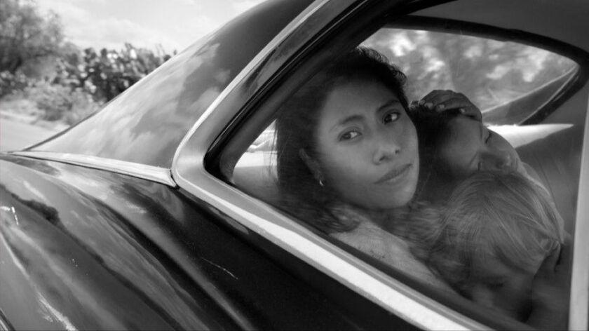 "Yalitza Aparicio as Cleo, Marco Graf as Pepe, and Daniela Demesa as Sofi in ""Roma,"" written and directed by Alfonso Cuarón."