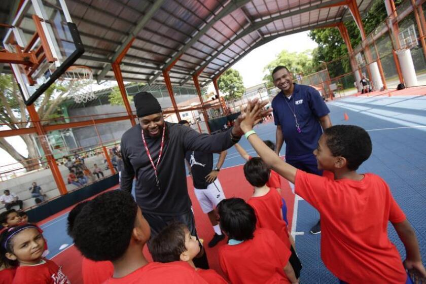 Sam Perkins, formerly of the NBA's Los Angeles Lakers, and retired Major League Baseball standout Carlos Baerga on Wednesday separately shared their sports experiences with 280 Panamanian children. Panama City, Panama, Dec. 12, 2018. EPA-EFE/Carlos Lemos.