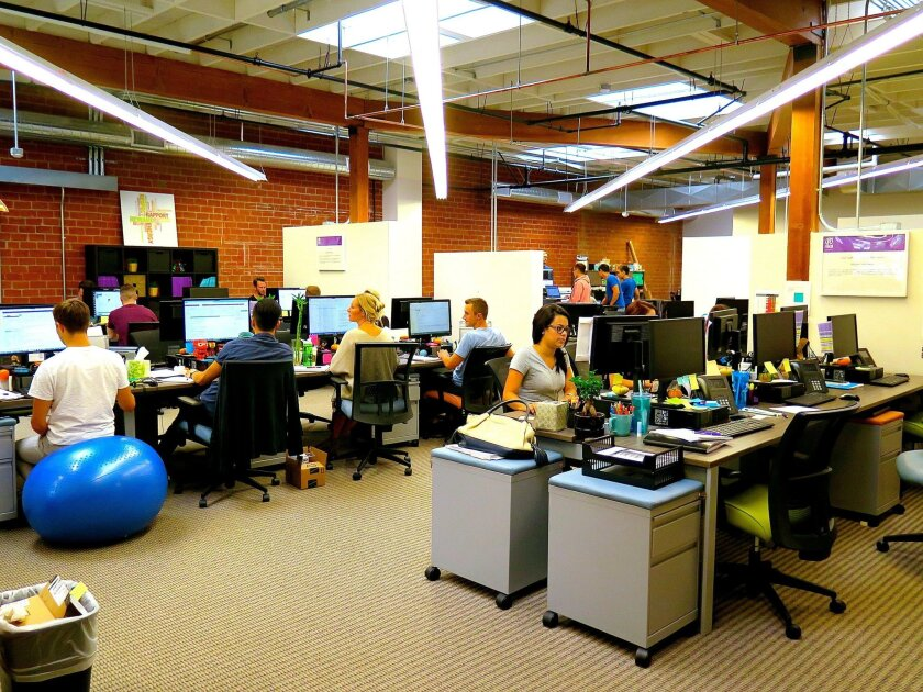 Co-workers at DeskHub sit next to each other at assigned desks that they pay for per month. There's minimal amount of storage but several spaces to congregate.