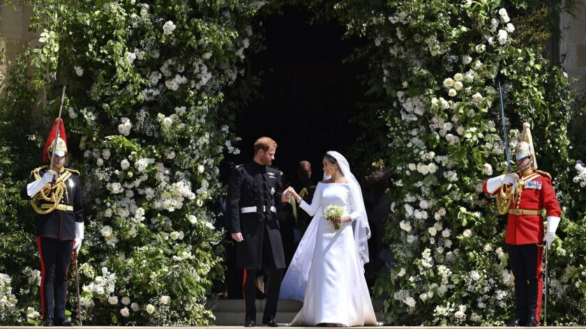 Prince Harry and Meghan Markle leave St. George's Chapel in Windsor Castle after their wedding cerem
