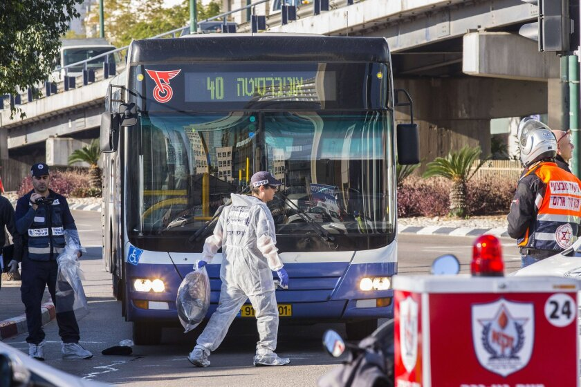 Authorities examine the scene of a stabbing attack on a Tel Aviv bus on Jan. 21.