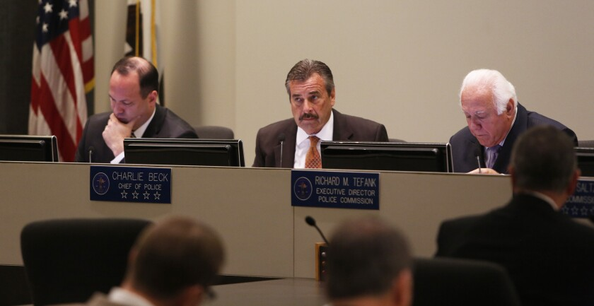 Inspector General Alexander A. Bustamante, left, LAPD Chief Charlie Beck, center, and Executive Director Richard M. Tefank, right, listen during Tuesday's police commission meeting.