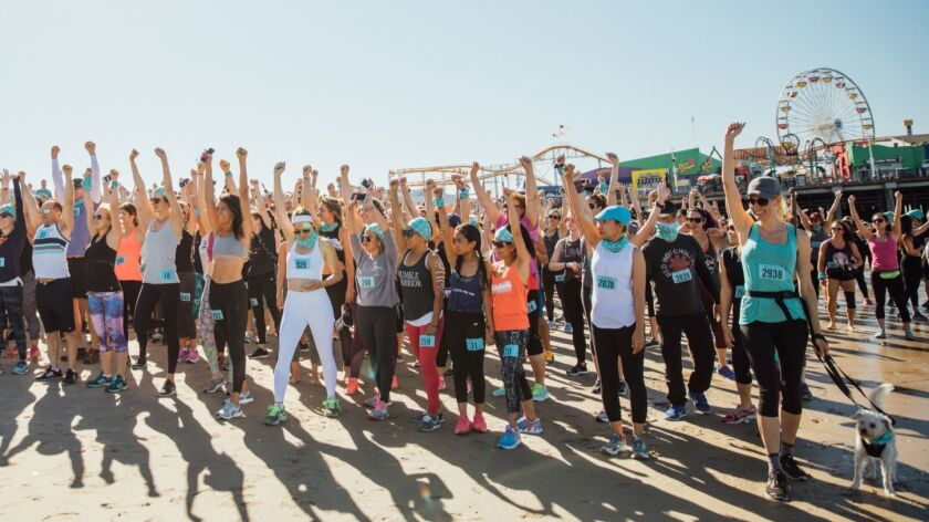 """A """"mindful triathlon"""" on the beach in Santa Monica combines running or walking with yoga and meditation."""