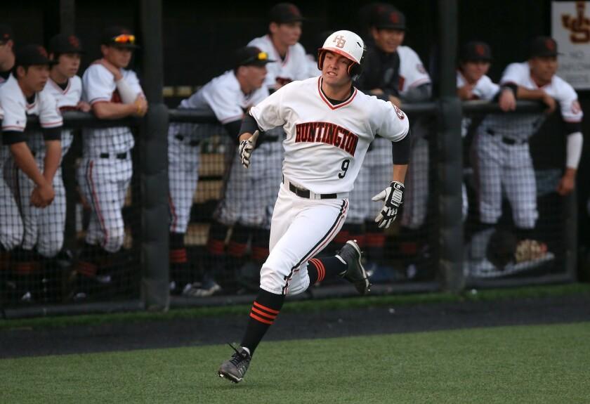 Huntington's Josh Hahn scores in the first inning against Cathedral Catholic in the Boras Classic So