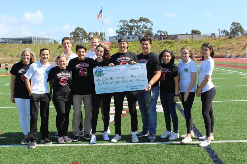 The Coach C Walk for Cancer raised funds for the American Cancer Society and junior Nick Herrmann who was battling cancer. Nick Herrmann, center with ASB members Jake Noble, Arie Bialostozky and ASB President Lindy Byrne and parent advisors Heather Dugdale and Stephanie Kowac, Relay for Life President Emily Roshan and Supporting Young Athletes members (in white): Jake Welton, Daniel Pruschki, Maddie Welton, Nathan Pollock and Mika Horton.