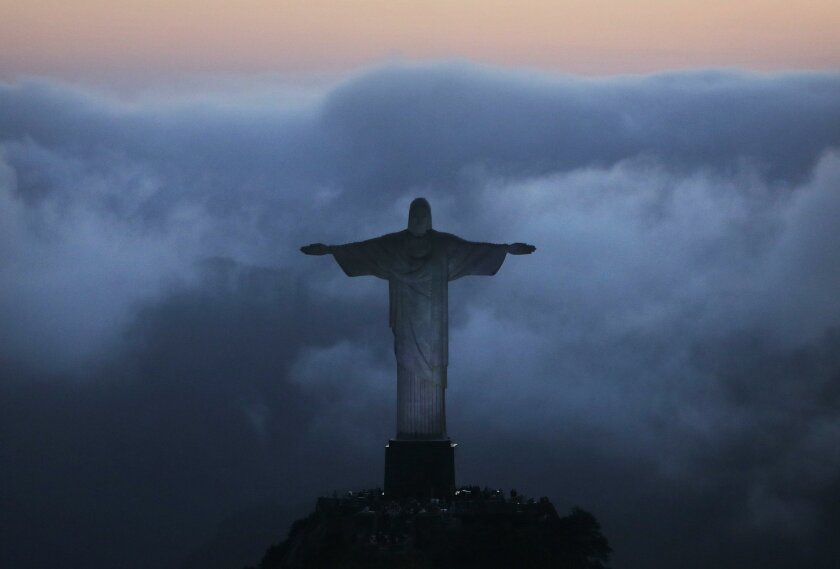 RIO DE JANEIRO, BRAZIL - JULY 31:  An aerial view of the Christ the Redeemer statue as Rio prepares for the 2016 Summer Olympic Games on July 31, 2016 in Rio de Janeiro, Brazil.  (Photo by Mario Tama/Getty Images) ** OUTS - ELSENT, FPG, CM - OUTS * NM, PH, VA if sourced by CT, LA or MoD **