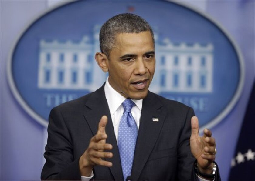"""President Barack Obama answering questions during his new conference in the Brady Press Briefing Room of the White House in Washington, Tuesday, April 30, 2013. The president brushed aside the suggestion he's lost political clout, saying """"rumors of my demise may be a little exaggerated.""""  (AP Photo"""