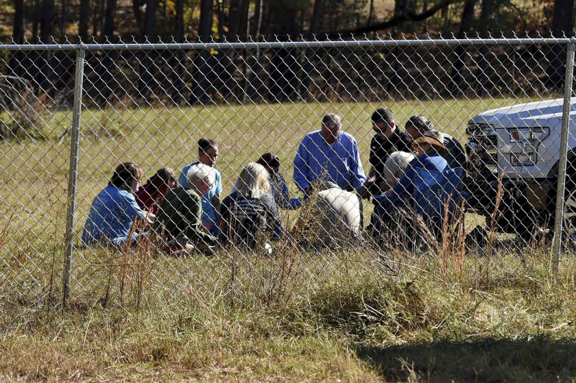 Duncan First Baptist church members, with South Carolina State Rep. Bill Chumley, hold a prayer service on Todd Kohlhepp's property in Woodruff, S.C. on Monday.