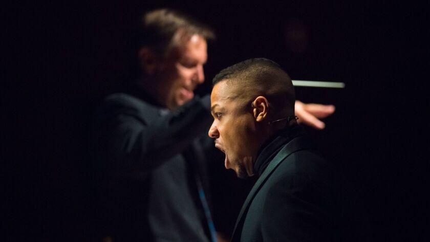 "Dav—óne Tines sings as Grant Gershon conducts at a performance of John Adams' ""El Niño."""