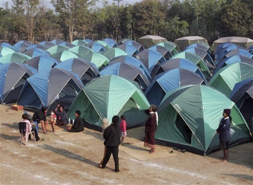 Thai refugees gather in tents set up for people fled the battlefront, near Sisaket, Thai border with Cambodia, Monday, Feb. 7, 2011. Troops of Cambodia and Thailand continue to clash near the 11th century Preah Vihear temple, a world Heritage site on the Cambodian side of the border. The crumbling