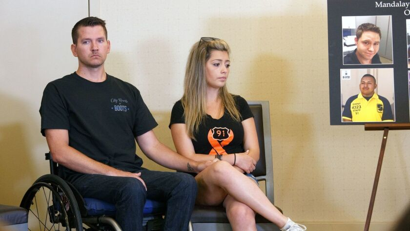 Jason McMillan, who was paralyzed in the October 2017 mass shooting in Las Vegas, and fiancee Fiorella Gaete at a news conference this week in Newport Beach.