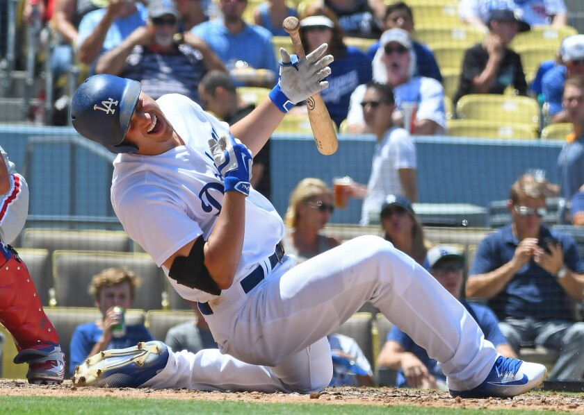 Dodgers shortstop Corey Seager goes down after being hit on the right wrist by a pitch from Philadelphia Phillies reliever Elvis Araujo in the sixth inning.
