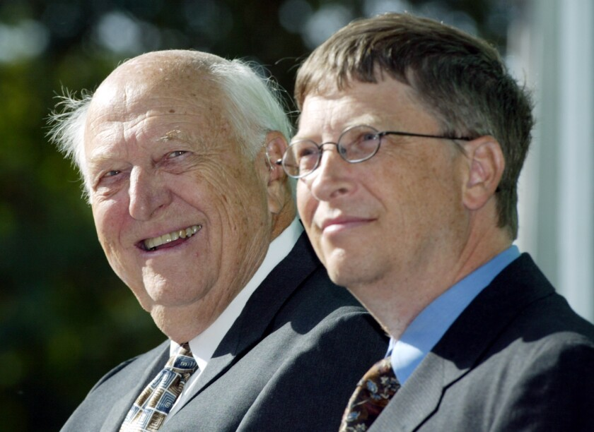 William H. Gates Sr., left, with his son, Bill Gates Jr., during the dedication of the William H. Gates Hall on 2003.