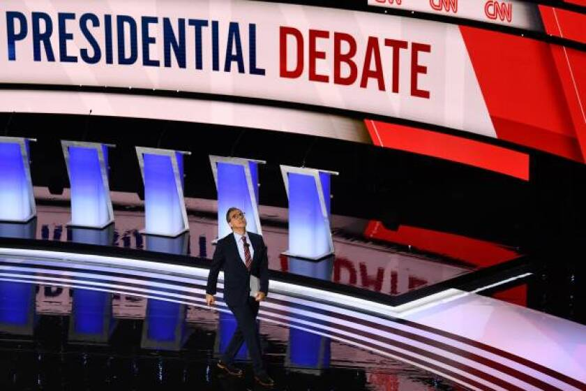 Moderator CNN chief Washington correspondent Jake Tapper walks onstage ahead of the first round of the second Democratic primary debate of the 2020 presidential campaign season hosted by CNN at the Fox Theatre in Detroit, Michigan on July 30, 2019.