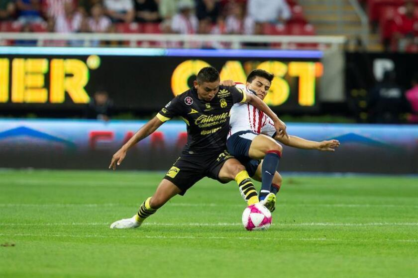 Fernando Beltran (R), of the Guadalajara Chivas, fights for the ball with Morelia's Miguel Sansores (L) during the Liga MX Apertura tournament match played on Oct. 27, 2018, at Akron Stadium in Guadalajara, Mexico. EPA-EFE FILE/Francisco Guasco