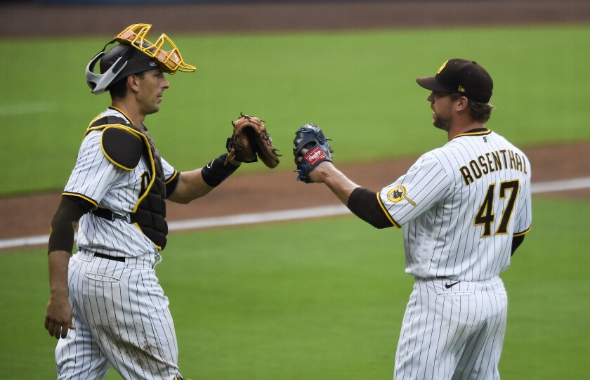 Trevor Rosenthal of the San Diego Padres is congratulated by Jason Castro