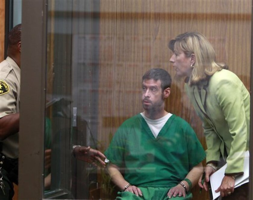 Brendan Liam O'Rourke and his attorney, Kathleen Cannon, receive instructions from a baliff as they wait in a holding area in  a San Diego Superior Courtroom where O'Rourke was arraigned on attempted murder charges stemming from an incident at the Kelly Elementary School in Carlsbad, Calif. Wednesd