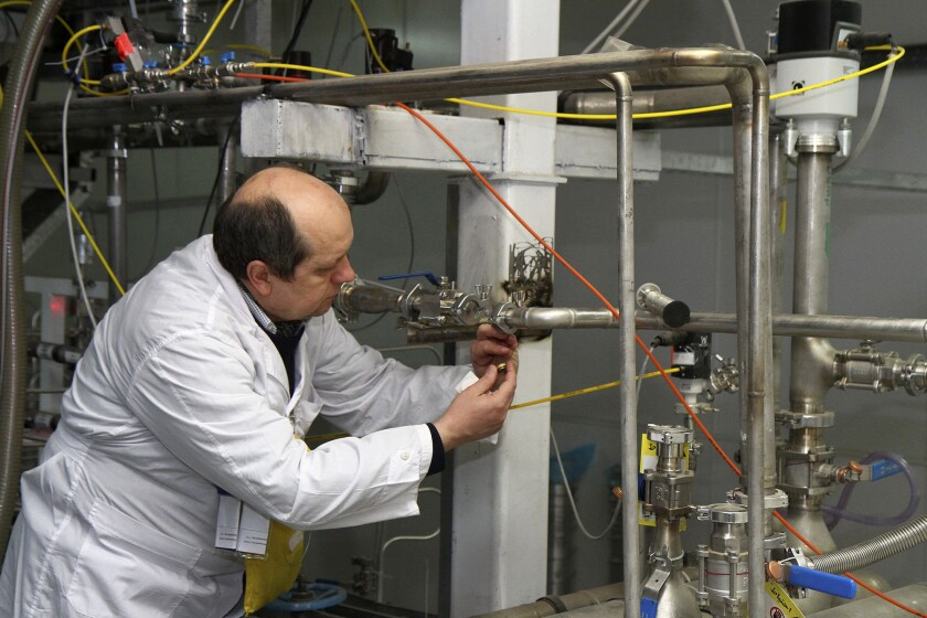 An International Atomic Energy Agency inspector works at a uranium enrichment facility in Natanz to verify that Iran is complying with a deal to begin rolling back its nuclear program.