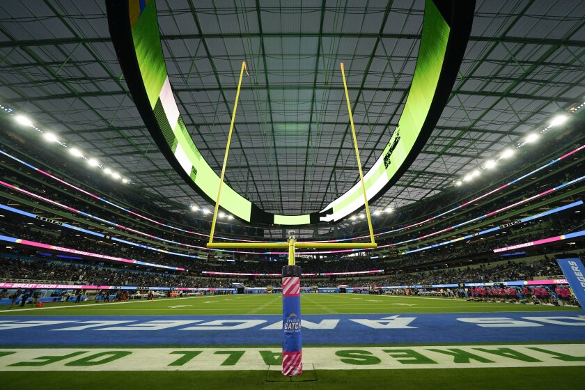 The field at SoFi Stadium sits empty during a weather delay shortly before the scheduled start of an NFL football game between the Los Angeles Chargers and the Las Vegas Raiders, Monday, Oct. 4, 2021, in Inglewood, Calif. (AP Photo/Ashley Landis)