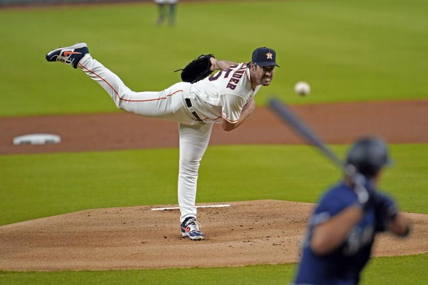 Houston Astros starting pitcher Justin Verlander throws to Seattle Mariners' Evan White.